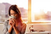 stock photo of plunger  - woman enjoys fresh coffee in the morning with sunrise at home lifestyle - JPG