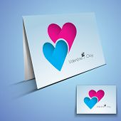 Valentines Day greeting card or gift card with heart design on blue background.