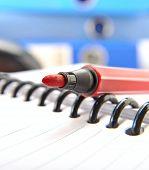 red soft-tip pen