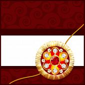 stock photo of rakhi  - beautiful golden rakhi with space for your text - JPG