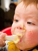 Messy Baby Boy Eating Mashed Potato