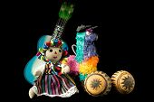foto of pinata  - Mexican doll pinata guitar hat and maracas isolated on black background - JPG
