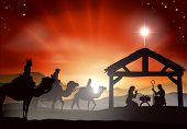 stock photo of nativity scene  - Christmas nativity scene with baby Jesus in the manger in silhouette three wise men or kings and star of Bethlehem - JPG