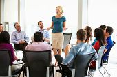 Businesswoman Addressing Multi-Cultural Office Staff Meeting