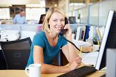 image of people talking phone  - Woman On Phone In Busy Modern Office - JPG