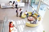 stock photo of reception-area  - Reception Area Of Modern Office Building With People - JPG