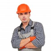 Portrait of confident worker in helmet isolated on white
