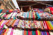 KATHMANDU, NEPAL - NOV 28: Unidentified street seller in historic center of city, Nov 28, 2013 in Ka