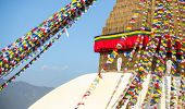 Bodhnath Stupa with Buddha Eyes in Kathmandu .