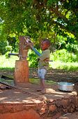 Kinazini, Kenya - July-12: Unidentified African Boy Is Showing A Water Well For Tourists With Tradit