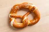 An image of a delicious bavarian pretzel on a wooden background