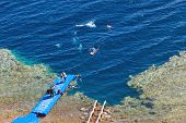DAHAB, EGYPT - JANUARY 30, 2011: Tourists diving in Blue Hole, popular diving location on east Sinai