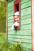 stock photo of bounce house  - Boy plays in little 