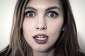 Scared face of women on white background