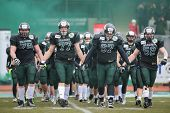 VIENNA,  AUSTRIA - APRIL 6 The team of the Danube Dragons enter the stadium before the AFL football