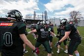VIENNA,  AUSTRIA - APRIL 14 OL Boris Lisiecka (#52 Dragons) is welcomed by his team before the AFL f