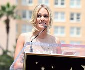 LOS ANGELES - MAY 23:  Carrie Underwood arrives to the Walk of Fame Ceremony for Simon Fuller  on Ma