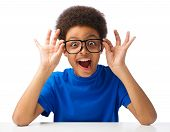 stock photo of excitement  - Funny portrait of excited African American teenager wearing glasses and smiling - JPG