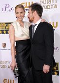 LOS ANGELES - JAN 16:  Leslie Bibb & Sam Rockwell arrives to the Critics' Choice Movie Awards 2014