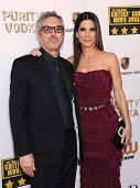 LOS ANGELES - JAN 16:  Alfonso Cuaron & Sandra Bullock arrives to the Critics' Choice Movie Awards 2014  on January 16, 2014 in Santa Monica, CA