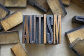 foto of aspergers  - The word AUTISM written in vintage wood letterpress type - JPG