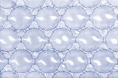 Blue bubble wrap with extra large blue bubbles for packing large fragile items.