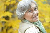 Thoughtful senior woman in autumn