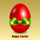 image of fragile sign  - Red Easter egg with green bow - JPG