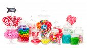 stock photo of jar jelly  - A candy buffet with a wide variety of candies in apothecary jars - JPG