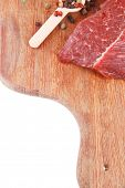 fresh raw beef meat fillet flesh with peppercorn and thyme ready to grill on wood board isolated ove