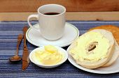 stock photo of bagel  - bagels with butter and coffee for breakfast - JPG