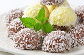 detail of coconut pralines on white plate