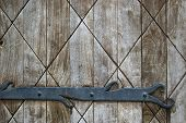 Abstract Background: Fragment Of Old Wooden Door With Decoration Element