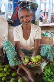 HIKKADUWA, SRI LANKA - MARCH 9, 2014: Local market vendor selling lime. The Sunday market is a fantastic way to see Hikkaduwa's local life come alive along with fresh produce and local delicacy.