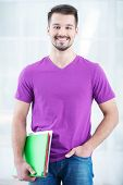 Teenage student smiling with folders