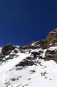picture of avalanche  - Snowy rocks with traces from avalanche - JPG