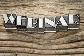 webinar word (web seminar) in letterpress metal type printing blocks against weathered grained wood