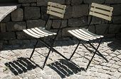 Two vintage folding chairs