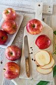 Apples on a rustic chopping board