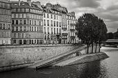 Постер, плакат: Seine River Bank on Ile Saint Louis Paris France