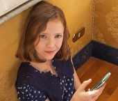 A Girl Holding The Phone