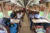 HIKKADUWA, SRI LANKA - FEBRUARY 22, 2014: Local commuters sit in train to Colombo. Trains are very c