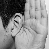 picture of disobedient  - Asian man holds his hand near his ear and listening - JPG
