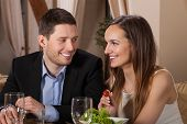 Couple Laughing In A Restaurant