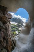 stock photo of crevasse  - Knobtop mountain framed by rocks and snow crevasse