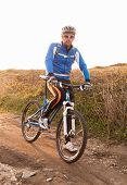 Mountain Bike Rider Looking At Camera.