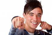 Young handsome male teenager makes telephone call sign