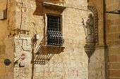 pic of corbel  - Wall with sculptures at the corner of the street in Valletta - JPG