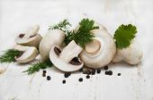 picture of crimini mushroom  - Champignon mushroomsherbs and spices on a white wooden background - JPG