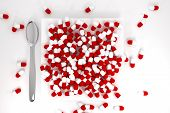 Large Pile Of Red Colored Pills On White Plate